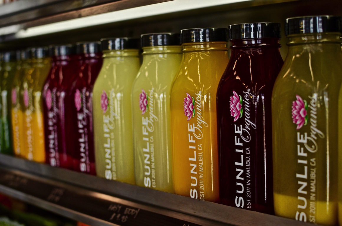 Shelf full of different juices at SunLife Organics in Manhattan Beach, California